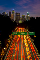 Fototapete - JANUARY 20, 2019, LOS ANGELES, CA, USA - Pasadena Freeway  (Arroyo Seco Parkway) CA 110 leads to downtown Los Angeles with streaked car lights at sunset