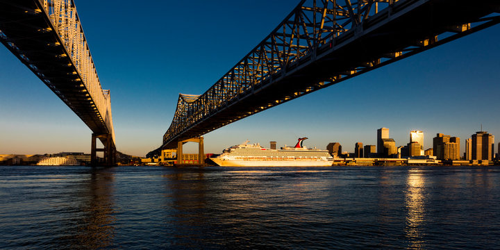 APRIL 27, 2019 LOUISIANA, USA -Crescent City Bridges cross Mississippi River from Algiers Point to New Orleans, Louisiana