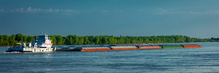 MAY 1, 2019, NEW MADRID, MO., USA - Barge heads North up Mississippi River towards St. Louis as seen from New Madrid, MO.