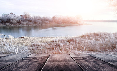 Photo sur Aluminium Taupe Winter background. Winter snow landscape with wooden table in front. Winter sun, ray, glare. Empty natural scene with a wooden table.