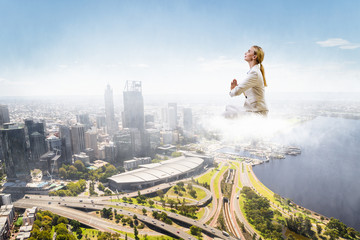Woman float above city . Mixed media
