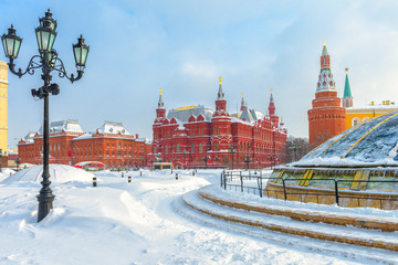 Fototapete - Moscow in winter, Russia. View of the snowy Manezhnaya Square, tourist attraction of the city. Panorama of the Moscow center during snowfall.