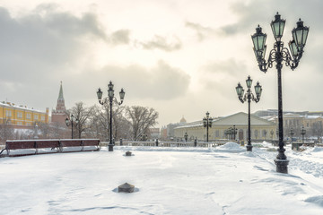 Fototapete - Moscow in winter, Russia. Snowy Manezhnaya Square near Moscow Kremlin. Panoramic view of the Moscow city center during snowfall. Nice scenery of Moscow street under snow for background.