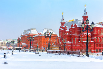 Fototapete - Moscow in cold winter, Russia. Scenery of old historical buildings on the snowy Manezhnaya Square near Moscow Kremlin.