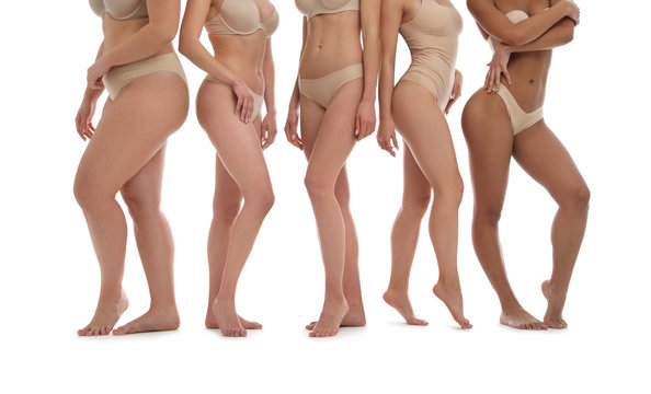 Group of women with different body types in underwear on white background, closeup