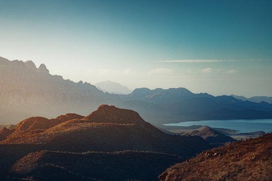 Sun rising over mountains and a bay near Loreto, Mexico