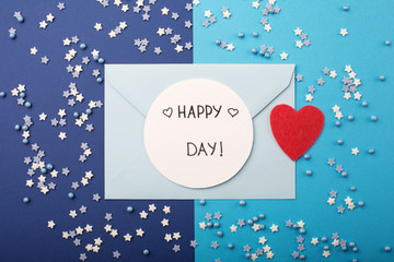 Blue envelope, small stars and red heart on classic blue