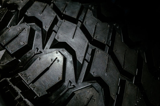 Grooves detail of a black rugged terrain tire for heavy duty offroad cars and trucks
