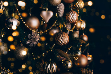 In de dag Bomen Decorated christmas tree with golden toys on dark background. Christmas concept, 2020.