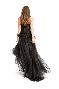 Woman back Rear view in Black Dress, Beautiful Fashion Model walking away in Long Gown on White Background