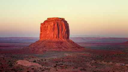 Spoed Fotobehang Bordeaux Sunset in the famous Monument Valley, on the border between Arizona and Utah. Navajo tribal park