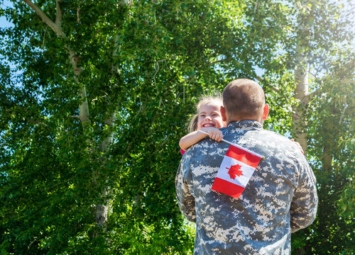 Reunion of soldier from Canada with family, daughter hug father