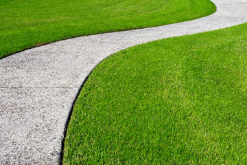 Foto auf AluDibond Gras A thick carpet of zoysia grass and an oyster shell tabby pathway suggest the abstract concept of a journey, or of a beautifully maintained garden.