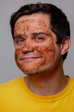 beautiful brunette man with coffee beans mask