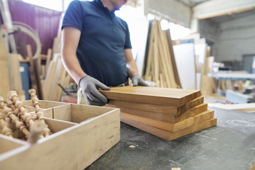 Carpentry workshop making wooden furniture, woodworking industry