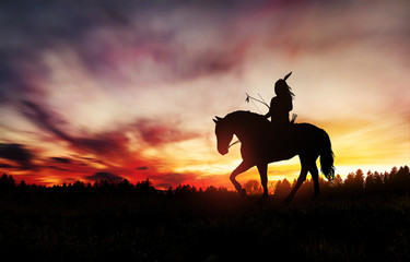 Indian of America on horseback at sunset Fotomurales