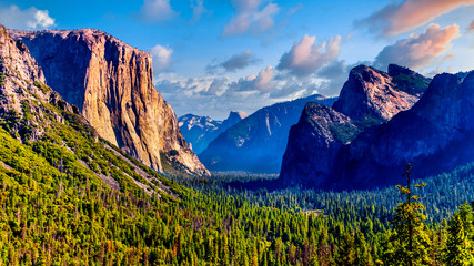 Tunnel View of Yosemite Valley with famous granite rock El Capitan on the left and dry Bridalveil Fall and imposing Cathedral Rocks on the right in Yosemite National Park, California, United States