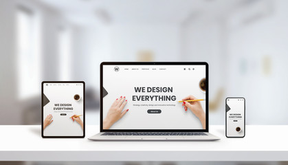 Responsive agency web page on laptop, tablet and phone display concept. Modern, flat web page design. Modern devices with thin edges. Office, studio desk