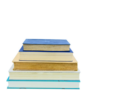 Books, stacked over one another in front of a white background