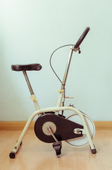 Spoed Foto op Canvas Fiets vintage cycling machine or aerobic spin exercise bike, healthy lifestyle concept, sweet color tone effect