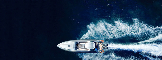 Fototapeta Aerial drone ultra wide panoramic photo of high speed inflatable rib boat cruising in high speed in tropical exotic bay obraz