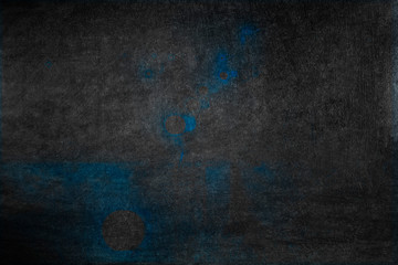 Dark grunge texture with blue spots. Backgrounds.