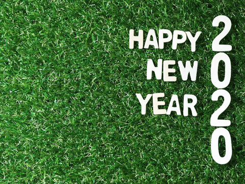 Happy new year 2020  grassed concept on green background