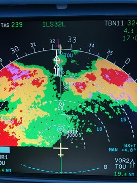 Airliner on board weather radar displaying weather returns landing during a storm