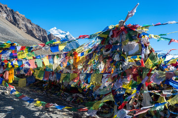 flags on a mountain pass in the Himalayas