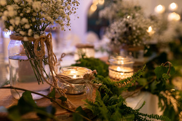 Beautiful wedding floral decoration, rustic top view of table with wood, plants, candles. Valentines day floral table decoration.