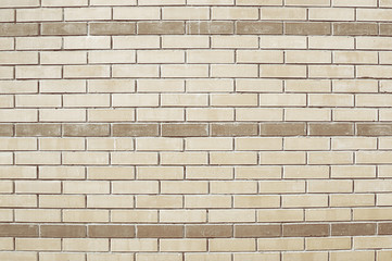 Old beige brick wall background
