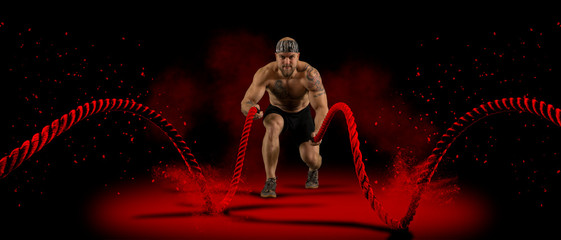 Papiers peints Fitness Man working out with battle ropes