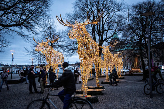 People stroll among Christmas light installations formed as elks at the Raoul Wallenberg Square in central Stockholm