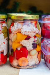 Homemade mixed pickles jars of marinated vegetables