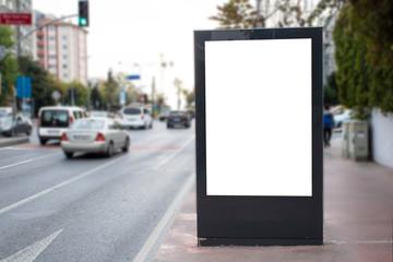 Blank white rectangular billboard at the roadside.