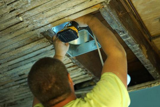 Installing fan box in a house.