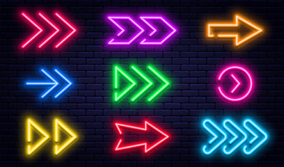Set of glowing neon arrows. Glowing neon arrow pointers on brick wall background. Retro signboard with bright neon tubes in red, yellow, purple and blue colors Fotomurales