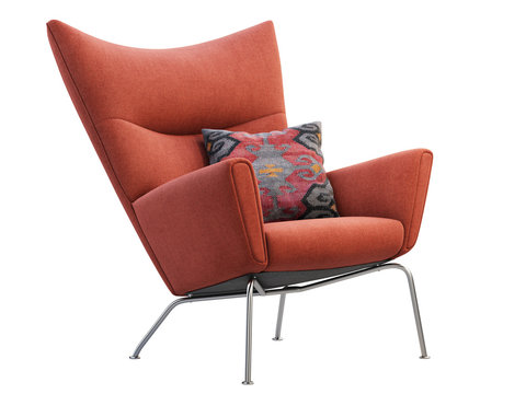 Mid-century red fabric wing chair with pillow. 3d render.