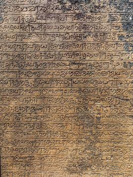 Ancient stone inscriptions in Singalese language texture. Pollonaruwa, Sri Lanka