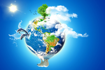 Planet earth with elements of nature and animals popping out