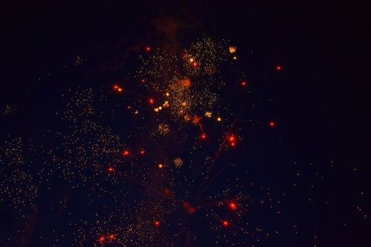 red and yellow fireworks on a black background