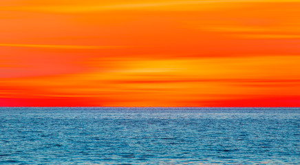 Wall Mural - Beautiful orange sunset and sea