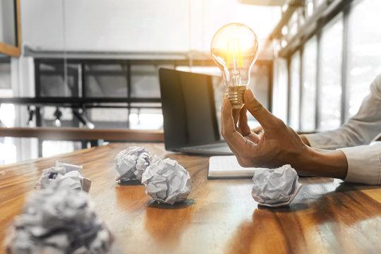 Woman holding light bulb  Idea creativity concept.