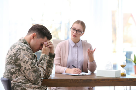 Psychotherapist working with military officer in office