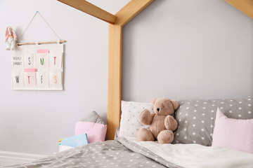 Stylish child room interior with comfortable bed