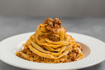 Tagliatelle al ragù alla Bolognese - long, flat egg pasta with a meat sauce or Bolognese sauce.
