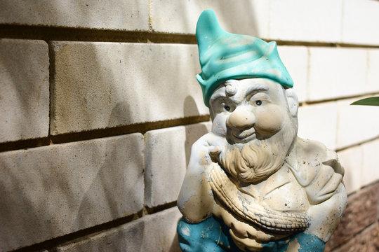 A garden gnome contemplates life
