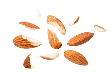 almonds baked pieces snack  and cracks Spread out  on white isolated .Clipping path -