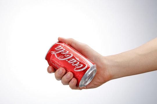 hand holding coca cola