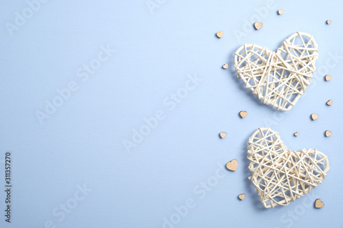 Handmade hearts on blue background. Banner or greeting card mockup for Valentine's or Mother's Day. Flat lay, top view, copy space.